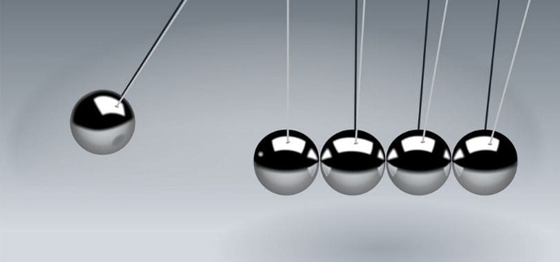 A close-up of Newton's cradle.