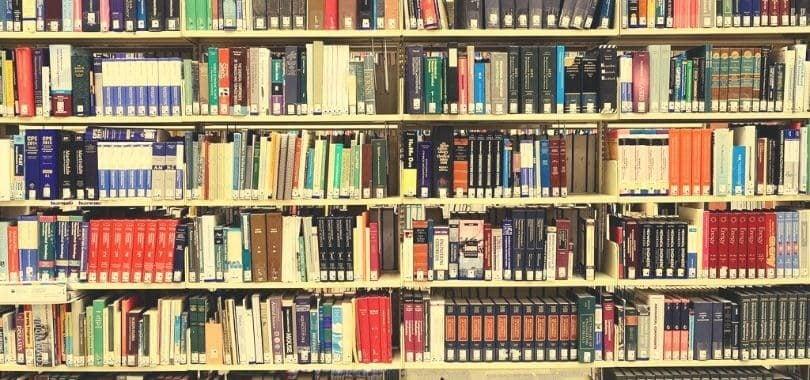 Books filling multiple bookshelves.