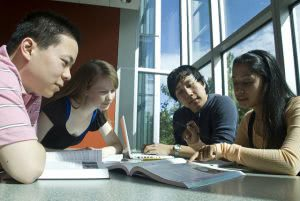 Group study of four students in the library.