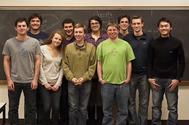 Students are posing in front of the chalkboard.