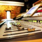 Close-up of an audio mixer.