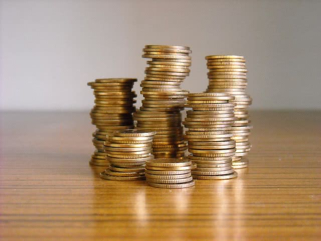 pile of coins for your loan repayment