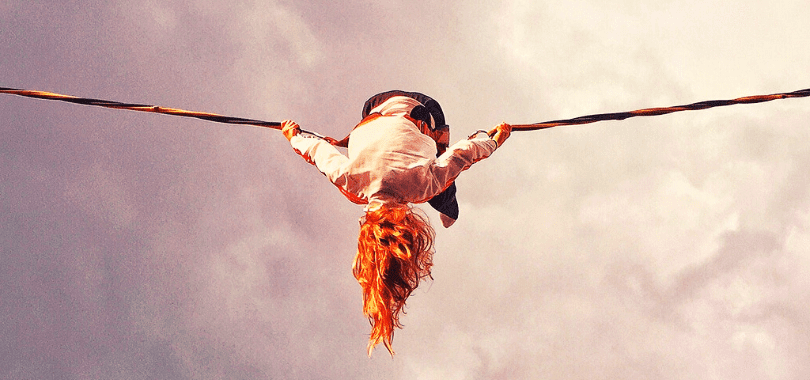 A student balancing on a tight rope.