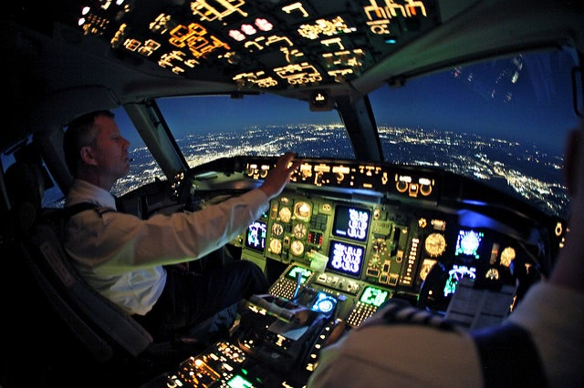 Pilot flying the airplane at night.