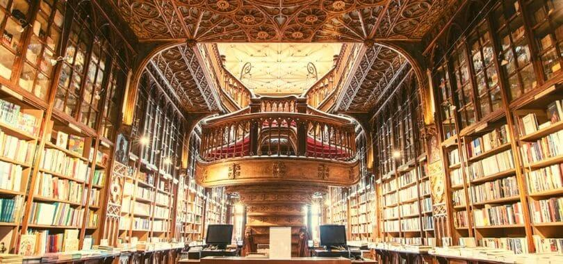 The interior of a library with a high ceiling.