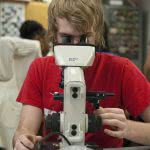 Student looking through the microscope.