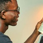 A student reading a book about employment law.