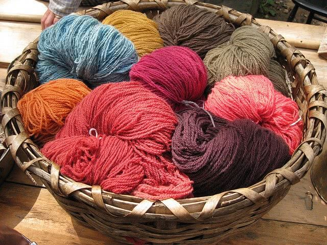 Colorful yarns in a basket.