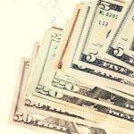 A stack of five and twenty dollar bills.