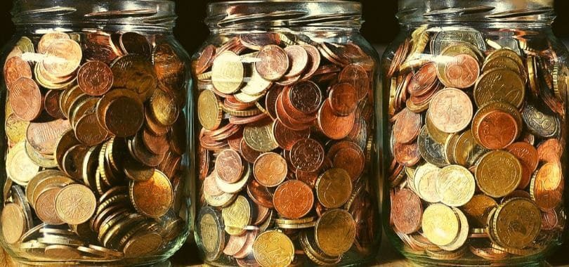 Three jars of coins in a row.