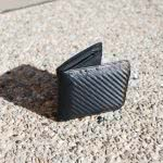 A black wallet on the ground.