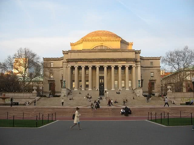 Columbia University Library with people on the foreground.