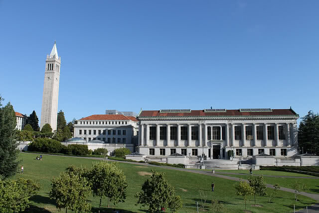 UC Berkeley Campus building and lawn on the foreground.