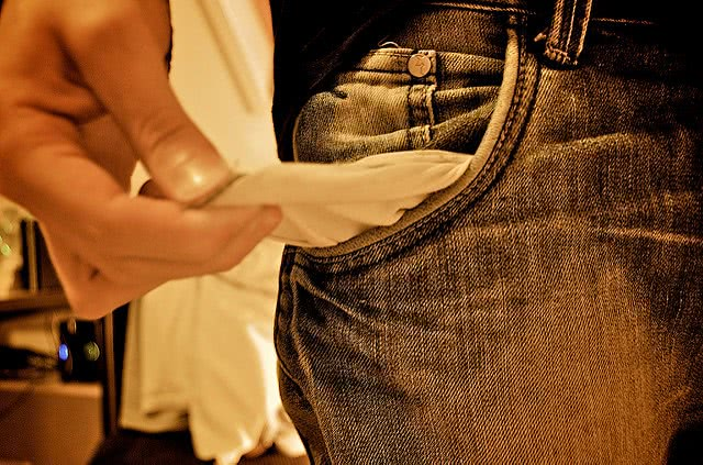 A man pulling his empty pocket.
