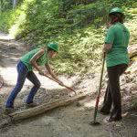 Two female volunteers are repairing the road of the Wonderland Trail.