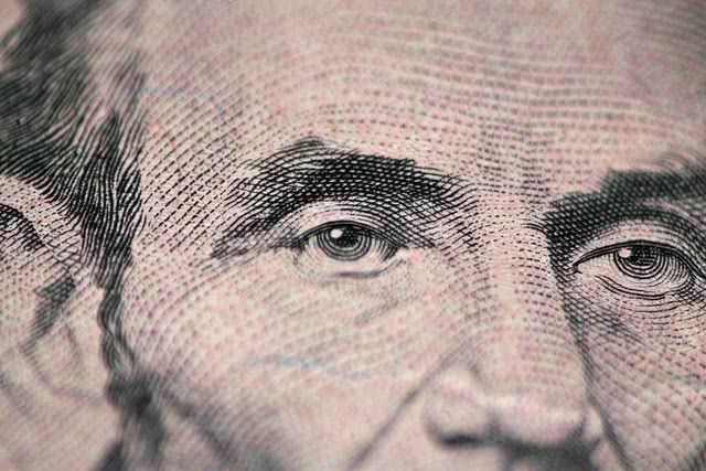 Close up of Abraham Lincoln in 5 dollar bill.