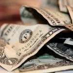 A crumpled dollar bills.