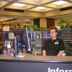 Student working at a library as part of a work study program