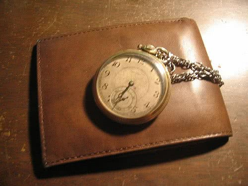 A watch on a wallet because time is money