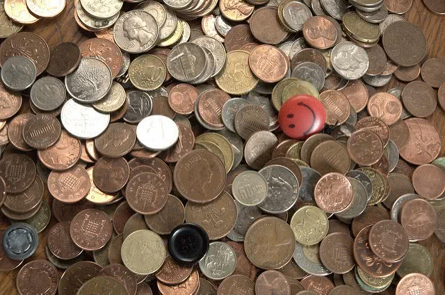 An assortment of coins - every penny counts for college savings