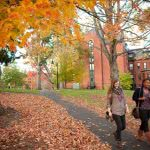 Students on campus in fall -- November is national scholarship month