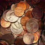 Pile of coins - can you save money by giving up your student loan grace period