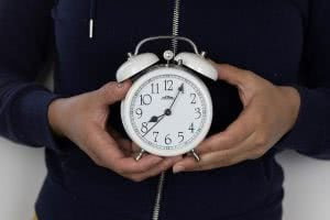 Girl holding alarm clock - make sure you don't miss the FAFSA deadline
