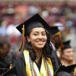 Student at graduation, wondering if she should refinance with Iowa Student Loan