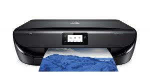 Slim black Envy printer printing out a photo of mountains. Click to view its Amazon page.