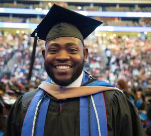 Student in cap and gown - after graduation you may need to refinance student loans. Here's our LendKey review.
