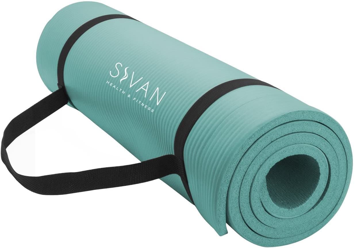 A teal yoga mat rolled up with a black strap.