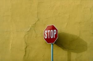 Stop sign - you can prevent student loan default by stopping it before it starts