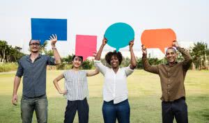 People holding speech bubbles - here's how to find scholarships by asking.