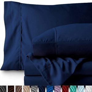 Navy colored bed sheets by Bare Home. Linked to its Amazon page.
