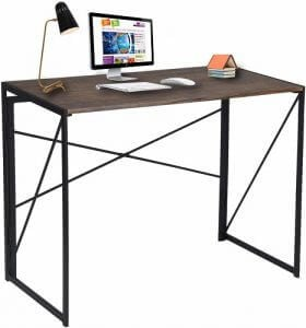 Brown writing desk by Coavas with lamp and computer on it. Click to visit its Amazon page.