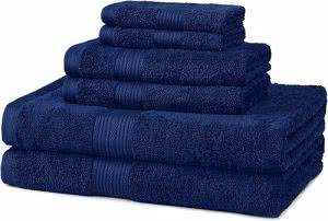 A stack of navy blue bath towels and washcloths by AmazonBasics. Click to visit its Amazon page.