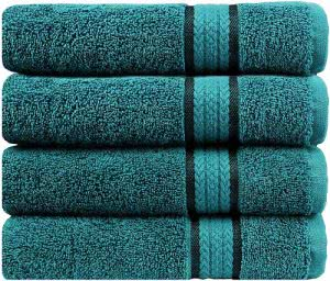 A stack of blue cotton towels by Cotton Craft. Click to visit its Amazon page.