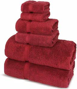 A stack of red towels, wash cloths, and hand towels by Chakir Turkish Linens. Click to visit its Amazon page.