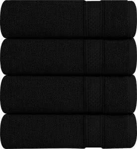 Four black folded towels by Utopia. Click to visit its Amazon page.