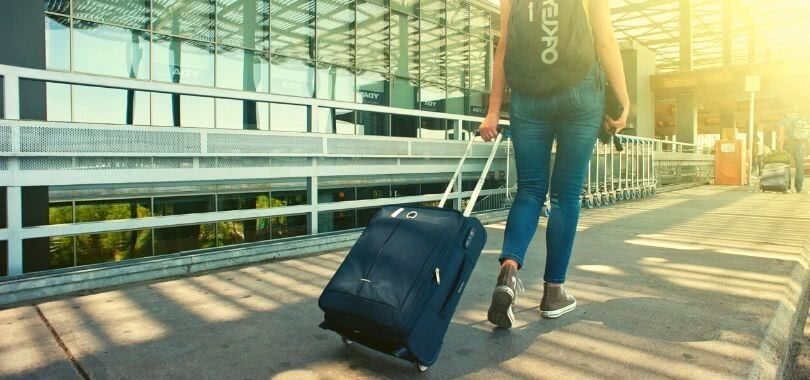 College student with suitcase at an airport