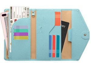 Aqua blue Zoppen passport wallet filled with cards. Click to visit its Amazon page.