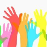 Colorful hand icons reaching for aid.