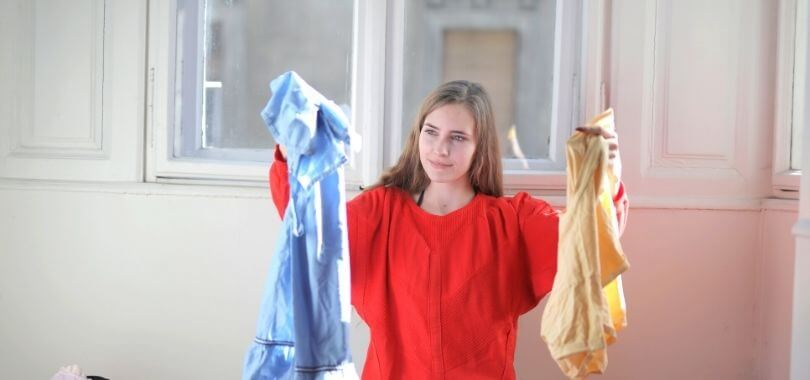 College student learning life skills like laundry.