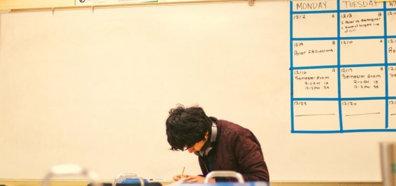 A college student working out his class schedule.
