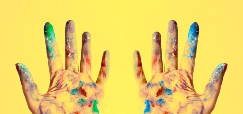 Paint covered hands.