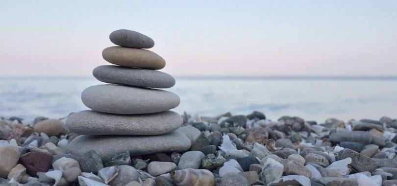 Balanced rocks on a lake