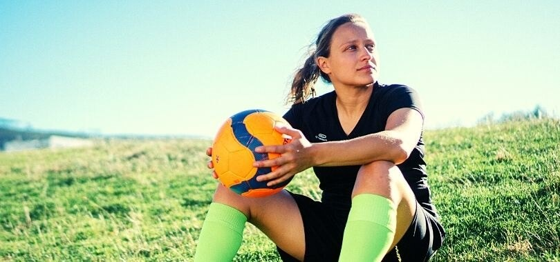 High school student playing soccer as an extracurricular activity